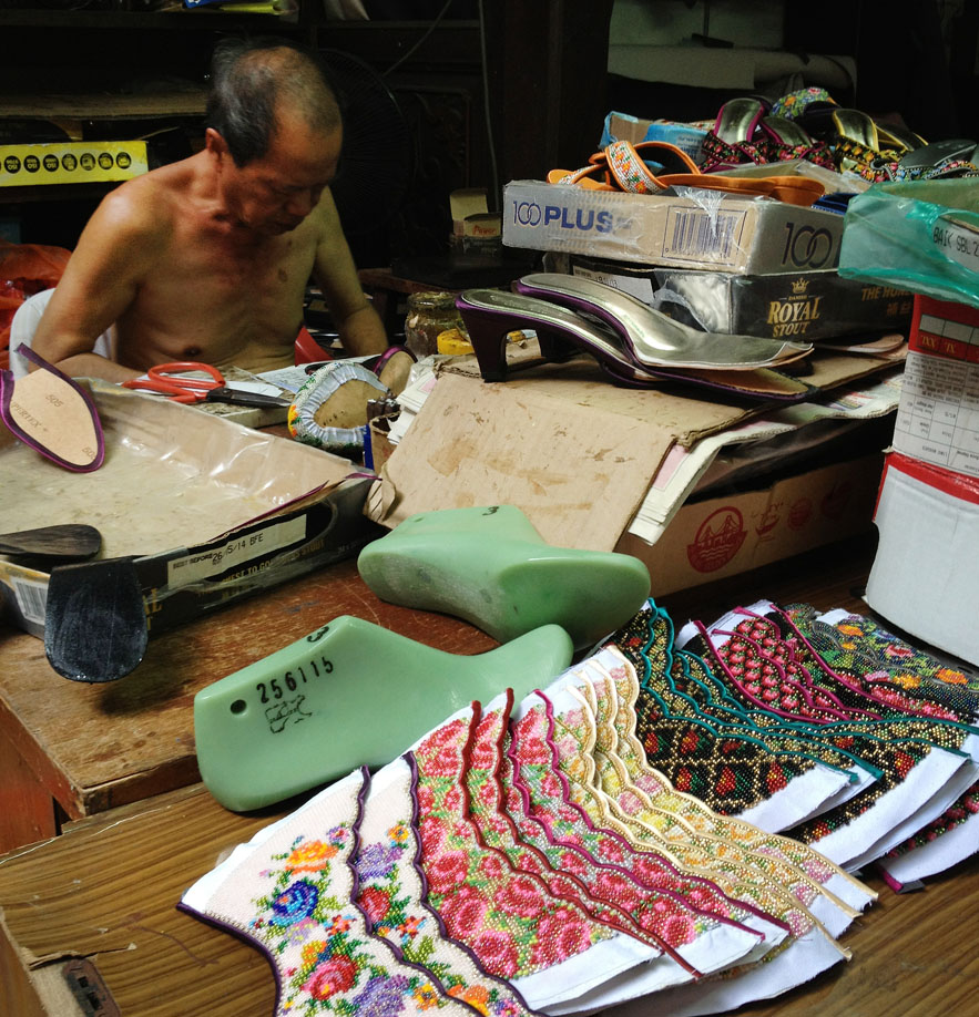 Beaded shoemaker in Malacca photo by Alexander Lamont