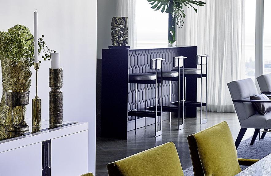 Carlos Domenech designed room with Alexander Lamont Bronze vessels on sideboard