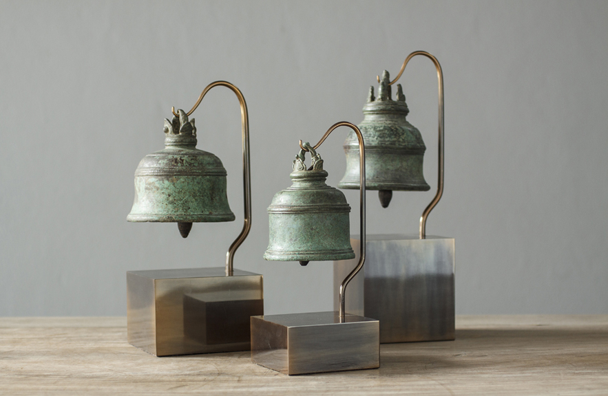 Antique bells on display stands designed by Alexander Lamont