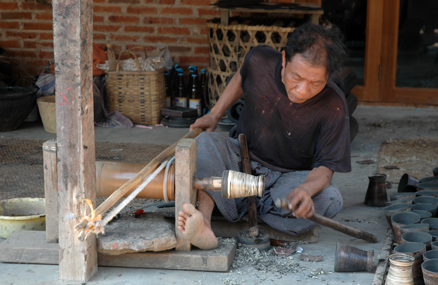 Burmese lacquer artisan at work.