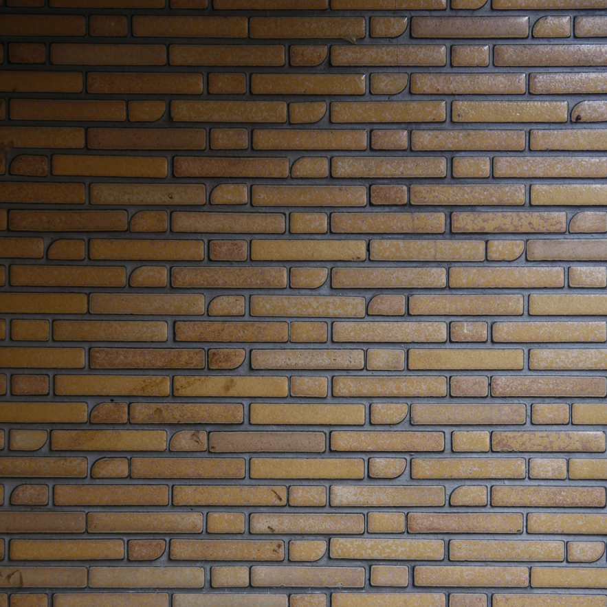 Brick wall in Japan by Alexander Lamont