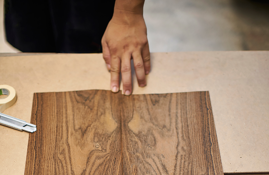 Alexander Lamont working with veneer finishes