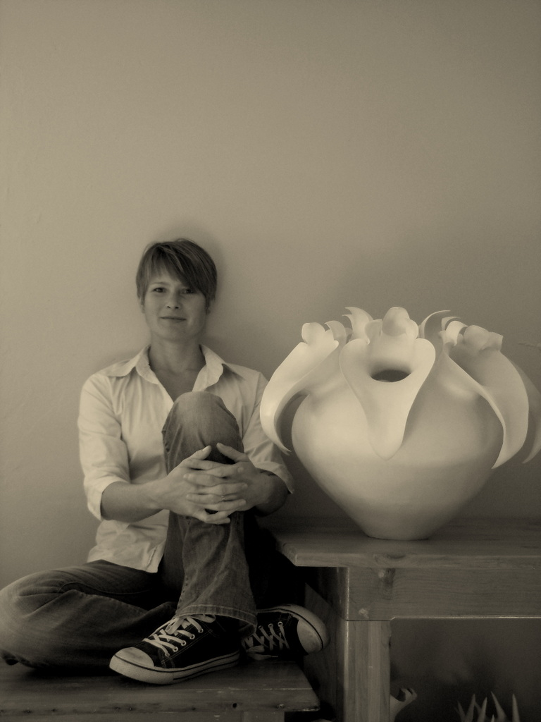Astrid Dahl and one of her white ceramic works